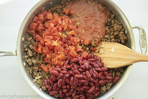 Beans, tomatoes and sauce added to ground beef