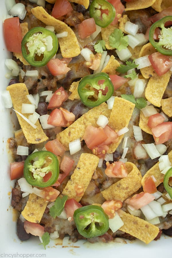 Closeup of Frito Pie Casserole with toppings