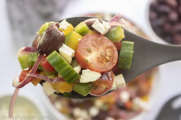 Fresh homemade Greek Salad on a spoon