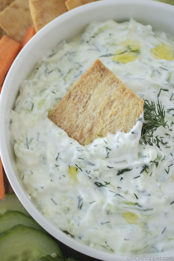 Greek Tzatziki Sauce in a bowl with pita chip