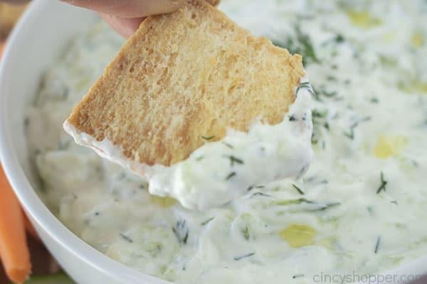 Dipped Pita chip in Greek Dip