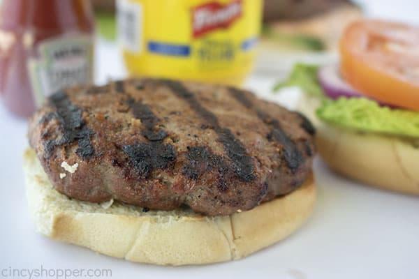 Grilled burger patty on bun