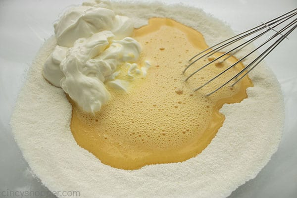 Eggs and sour cream added to dry ingredients