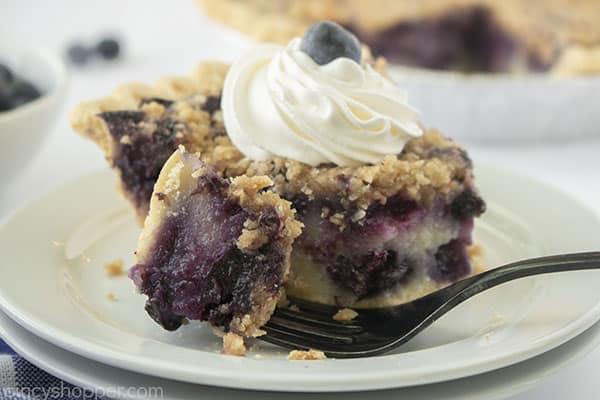 Slice with fork best blueberry pie