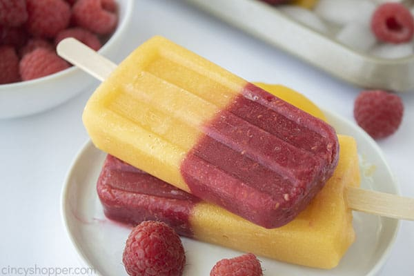 stack of popsicles made with berries and peaches