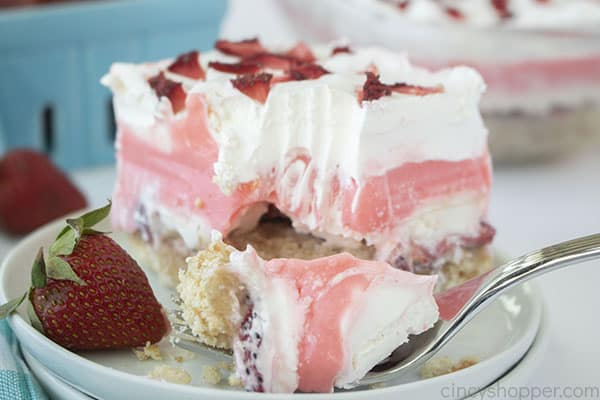 Strawberry Cheesecake layered dessert on a fork
