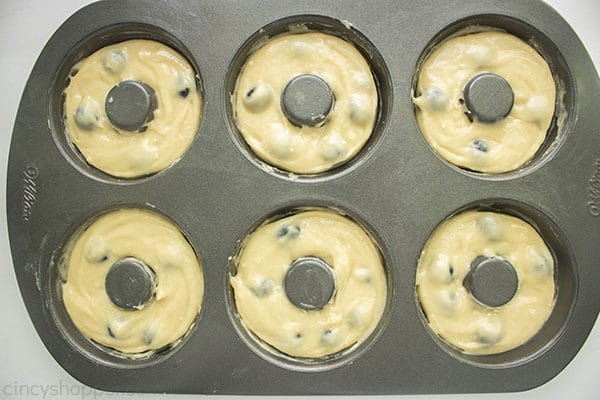Donut batter in pan with blueberries