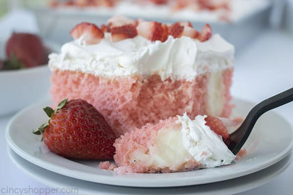 Strawberry Cake with cheesecake pudding on a fork