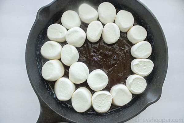 Marshmallows added to chocolate in pan