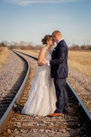 cog hill wedding formal pictures taken on train tracks