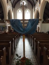 Cross with draped fabric