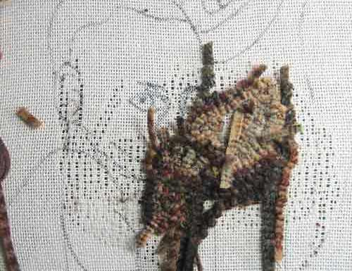 Rug hooking the baby's hand