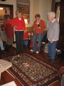 Pat Mensing showing off her rug to the studio class
