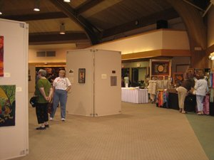 People enjoying the Sauder Village rug hooking exhibit