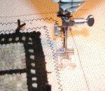 Finishing a hooked rug: zig zagging the edge