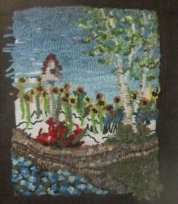 Adjusting the design of a rug hooked pictorial