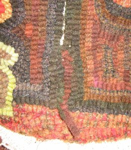Seam in a rug hooked footstool