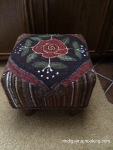 Rose Scroll footstool hooked by Pat Cassidy, pattern designed by Cindi Gay
