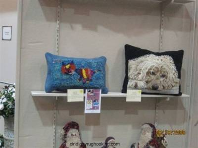 Ally's cat pillow on display