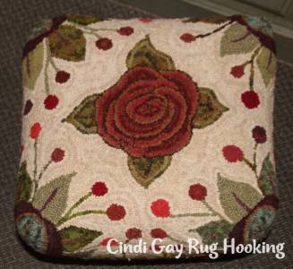Rug hooking footstool by hooked by Suz White