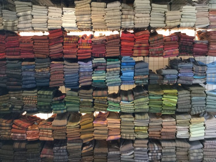 wall of wool Cindi Gay rug hooking studio