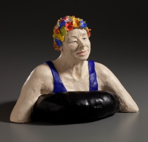 Figurative sculpture in clay woman swimming in bathing cap
