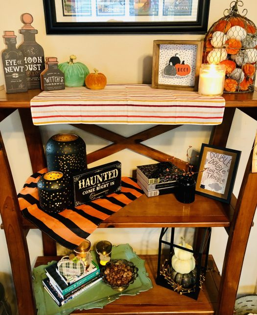 Decorating for Halloween with Decocrated tall bookshelf