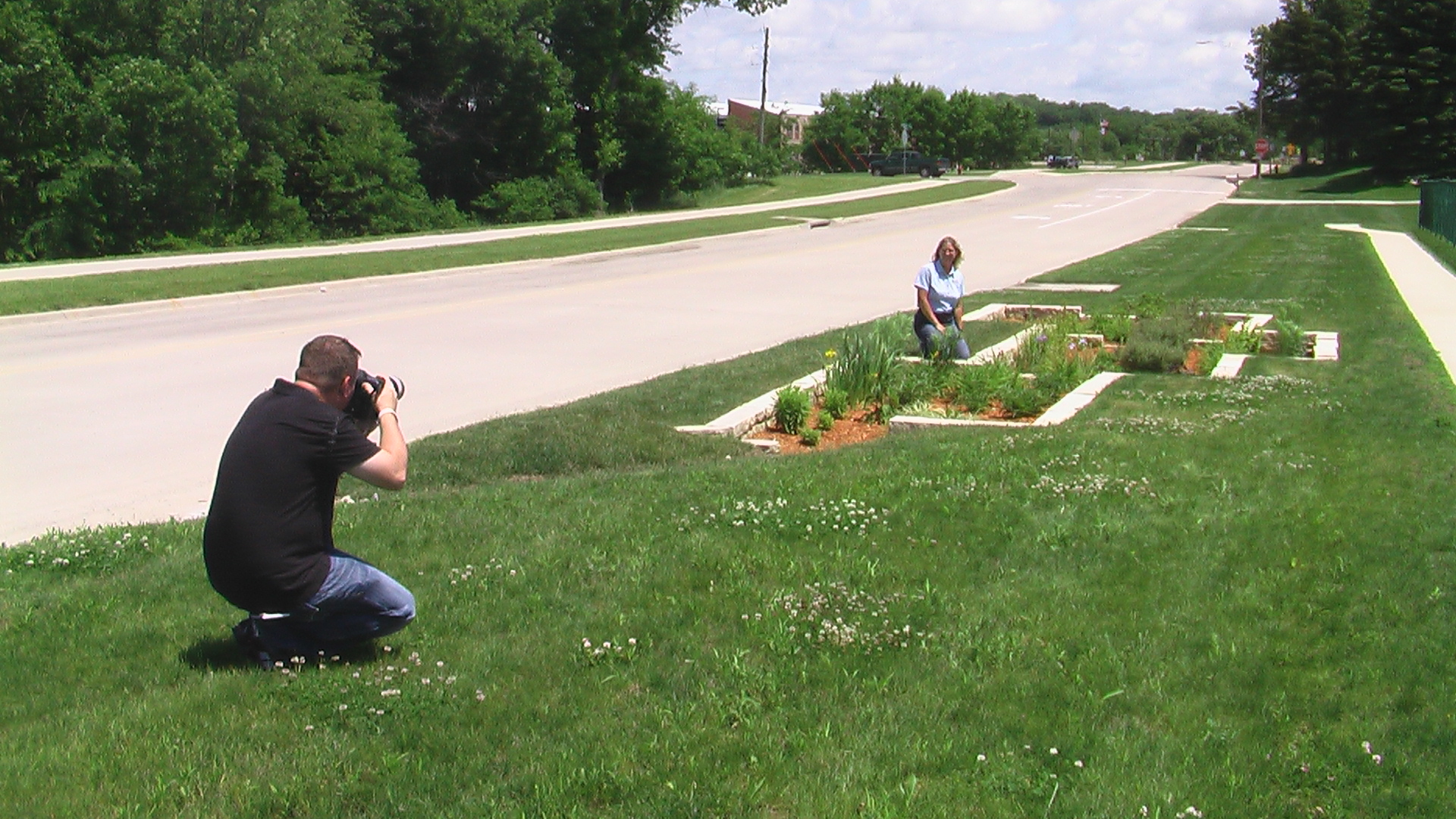 Gazette photographer Brian Ray takes photos of Lucy Hershberger in the rain garden at Forever Green Garden Center near North Liberty (photo, Cindy Hadish)