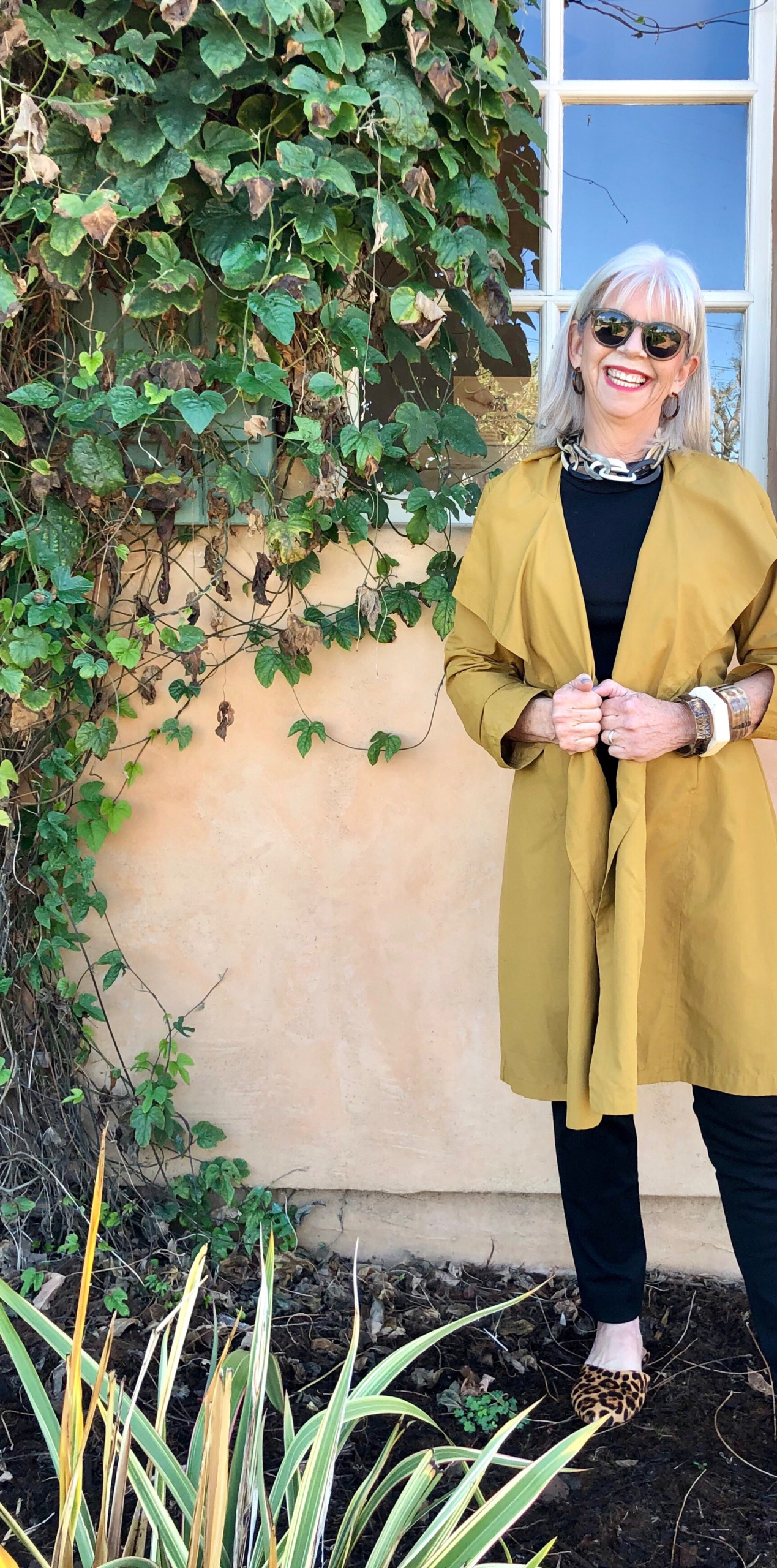 cindy hattersley in Eileen Fisher mustard trench