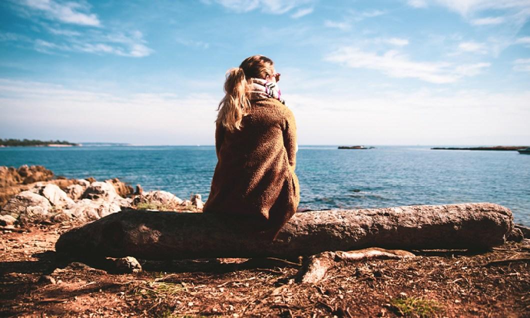 Woman looking out at lake
