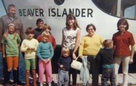 Dad and Mom with nine children on Beaver Island