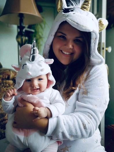 Courtney and her daughter Clara, dressed up as unicorns for Halloween.
