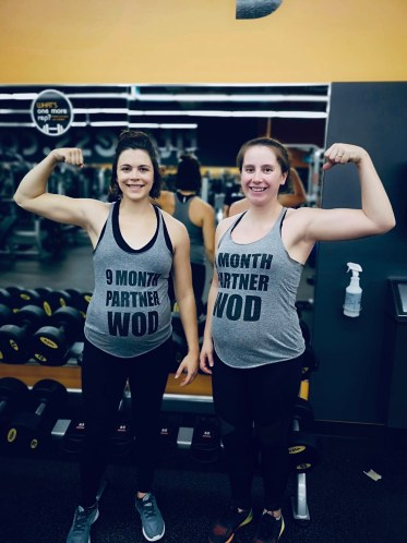 Charity and her friend Christina working out while pregnant.