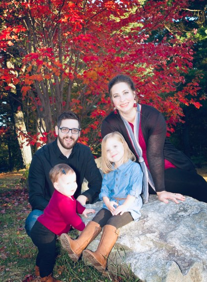 An outdoor fall photo of Cherie, Andrew and their two girls.