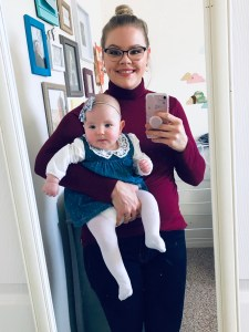 Katelyn holding Aubrey while they take a selfie together.