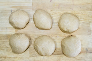 bread dough divided into 6 balls