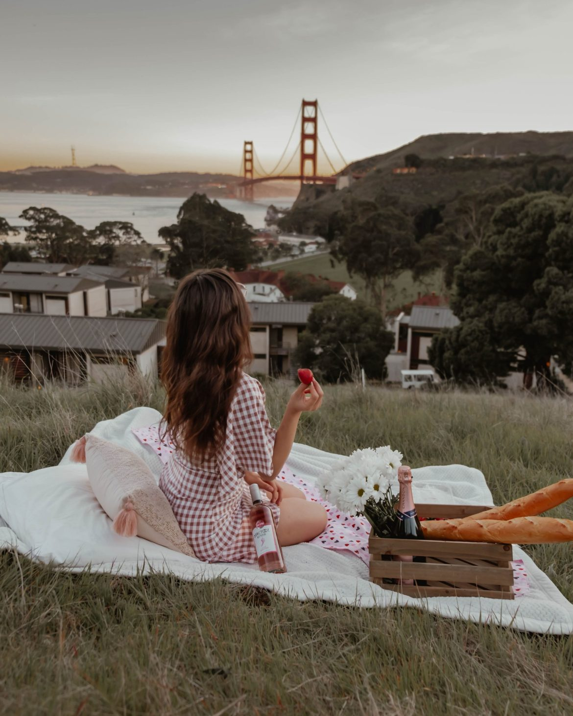 girl having a picnic in SF for sunset- Instagram worthy spots in San Francisco