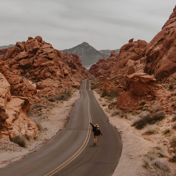 girl in the middle of the road at Valley of Fire, Nevada - Nevada & Arizona road trip guide and itinerary