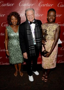 Presenter Alfre Woodard, Palm Springs Film Festival Chairman Harold Matzner and actress Lupita pose with the Breakthrough Performance Award for 12 Years a Slave backstage during the Cartier 25th annual Palm Springs International Film Festival & ShortFest awards gala.