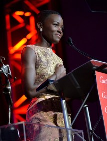 Honoree Lupita accepts the Breakthrough Performance award.