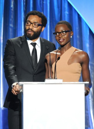 Lupita Nyong'o and Chiwetel Ejiofor speak onstage during the 25th annual Producers Guild of America Awards.