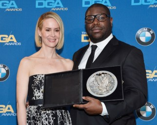 McQueen, recipient of the Feature Film Nomination Plaque for 12 Years a Slave, and actress Sarah Paulson pose in the press room during the 66th Annual Directors Guild Of America Awards.
