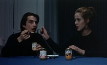 Antoine and Christine eating baby food after forgetting to buy groceries