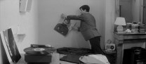 Antoine packing up his things, including a portrait of his 400 Blows-era self