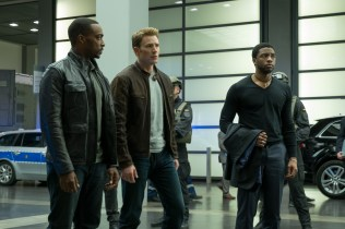 Marvel's Captain America: Civil War L to R: Falcon/Sam Wilson (Anthony Mackie), Captain America/Steve Rogers (Chris Evans), and T'Challa/Black Panther (Chadwick Boseman) Photo Credit: Zade Rosenthal © Marvel 2016
