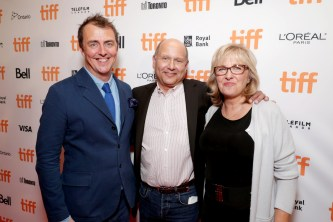 """Director/Writer Garth Jennings, Producer Christopher Meledandri and Producer Janet Healy seen at Universal Pictures """"Sing"""" at the 2016 Toronto International Film Festival on Sunday, Sept. 11, 2016, in Toronto. (Photo by Eric Charbonneau/Invision for Universal Pictures/AP Images)"""