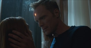 Marvel Studios' AVENGERS: INFINITY WAR..L to R: Scarlet Witch/Wanda Maximoff (Lizzie Olsen) and Vision (Paul Bettany)..Photo: Film Frame..©Marvel Studios 2018