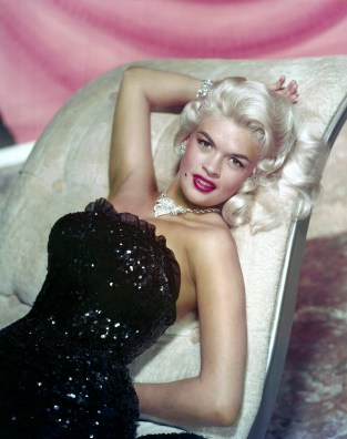 circa 1955: Studio portrait of American actor Jayne Mansfield (1933 - 1967) reclining on chaise longue in a strapless sequined gown and diamond jewelry.