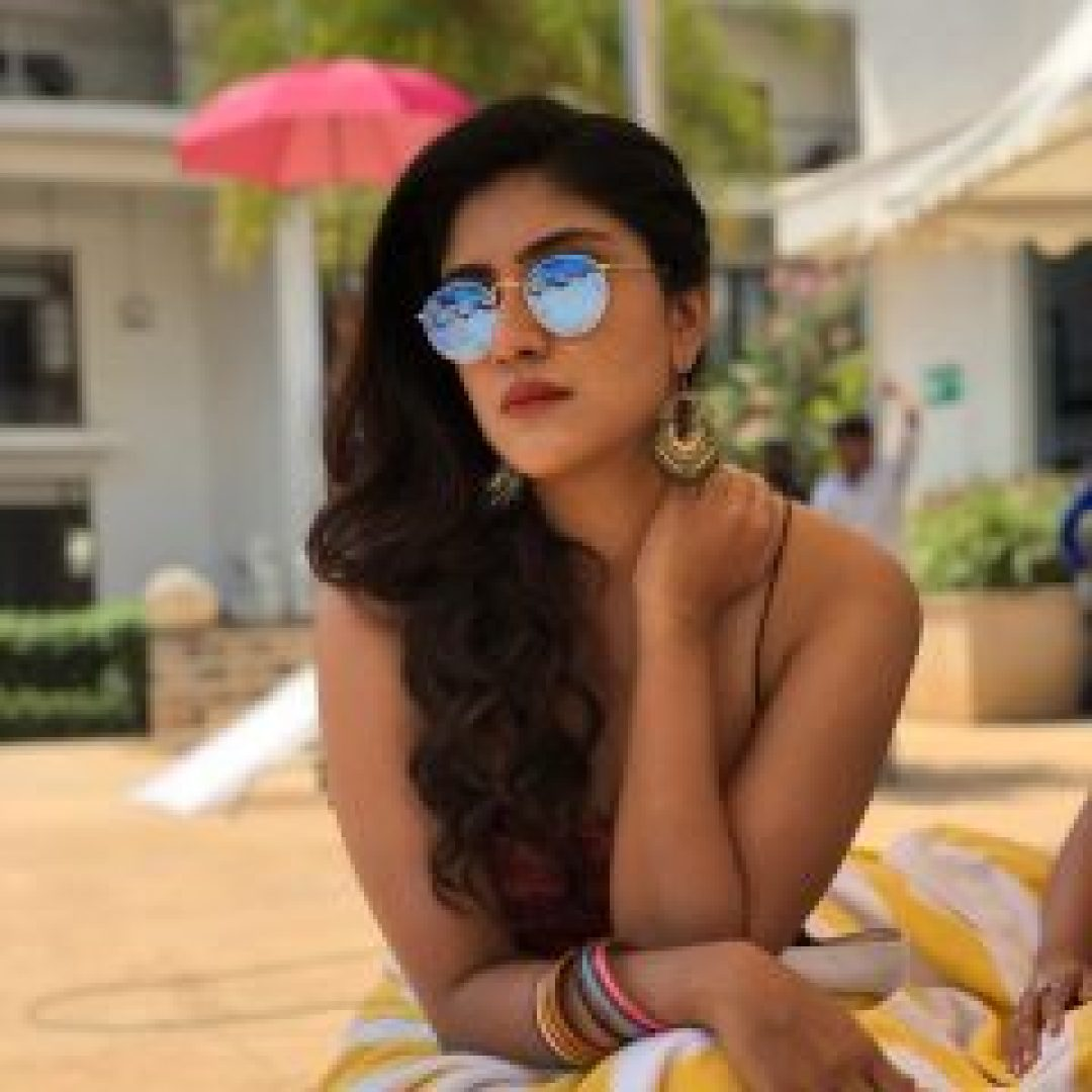 Dhanya Balakrishna with cooling glass