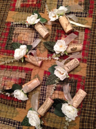 boutonnieres from wine corks, artificial flowers